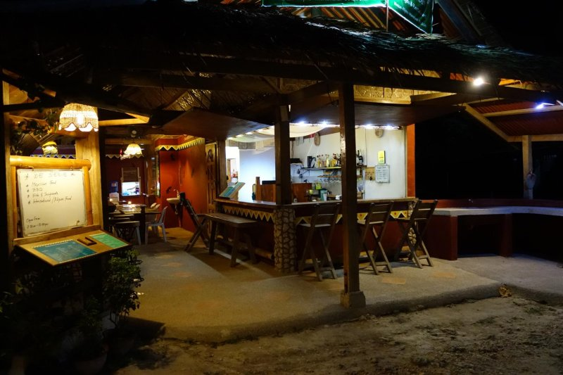 Maya's Native Garden restaurant/bar/cottages is directly across from Tipolo